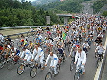 A road full of bicyclists.