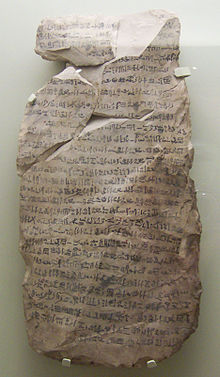 A stone fragment with cursive hieratic handwriting in black ink