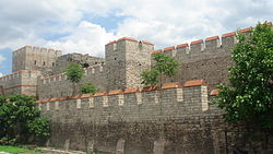 Triple series of stone walls reinforced with towers