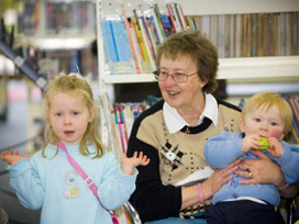 Grandmother with children in library