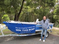 Winner of the IFS licence promotion boat package receives his prize