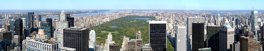 A large rectangular park stretches to the horizon behind a city skyline.