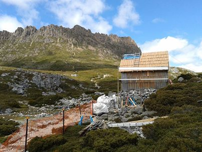 Photo: The restoration work on Kitchen Hut on the Cradle Mountain plateau is progressing well. Fine weather has enabled continuous work on the historic hut over the past two weeks which has included strengthening the internal structure of the hut and replacement of worn shingles.   With some work still to be done, bushwalkers are advised that the hut will remain closed until at least Monday the 10th of March. For further information please contact Parks and Wildlife Service, Cradle Mountain (03) 6492 1110.