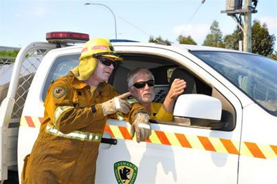 Photo: Mark Monks and Kent McConnell check on the progress of the burn.