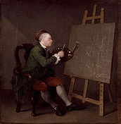 seated man painting a female figure on a dark canvas on an easel