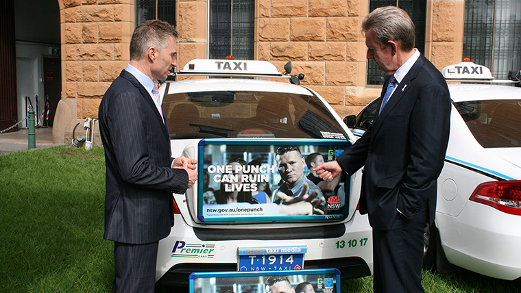 Premier O'Farrell and Taxi Council CEO Roy Wakelin-King with taxi signage