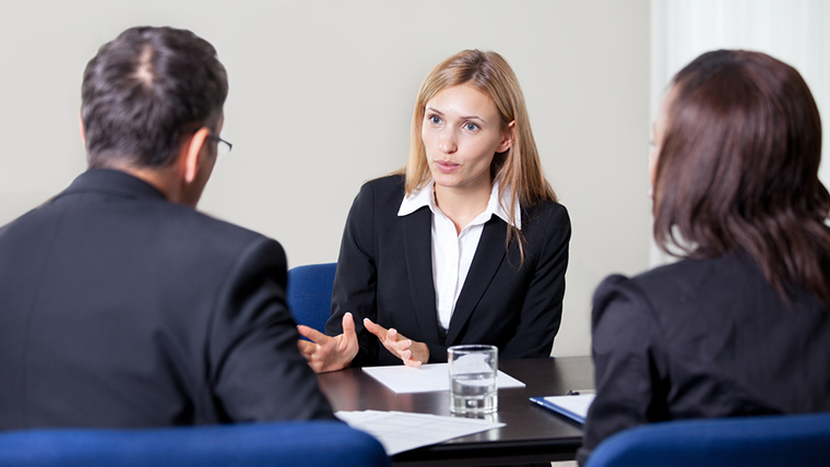 Three people in interview scene
