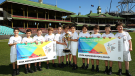 young boys with cricket posters