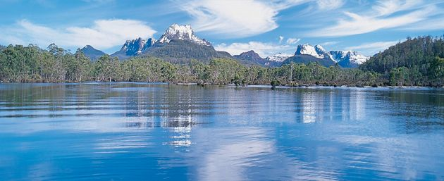 View across lake to snow-capped mountains