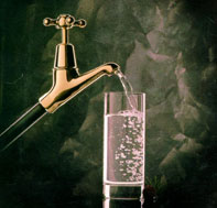 Photograph of tap and glass of water.